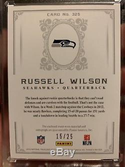 2012 NATIONAL TREASURES RUSSELL WILSON Black 15/25 Rookie Patch Auto RC JSY LOGO