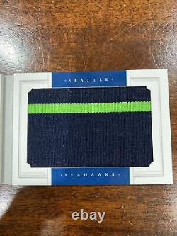 2012 national treasures russell wilson RC 11/49 Patch Auto Booklet